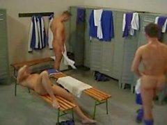 3 soccer players fuck in the locker room.