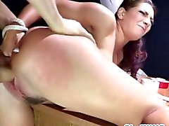 Roped slut fingers her ass while getting boned
