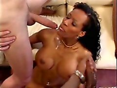Black whore with huge tits gets long cock shoved down her throat