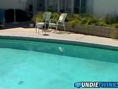 Handsome jock receives a handjob from his buddy by the pool