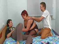 Mature redhead humped by two guys
