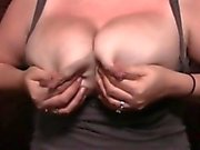 Big-breasted woman takes out her juicy tits and squeezes he