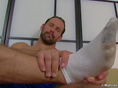 Bearded hunk cock teases with his amazing feet and toes
