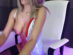 Busty blue eyed babe shows off her big round boobs on webcam
