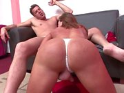 Tranny in a tight white thong blows big fat dong on the sofa
