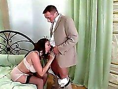 Pornstar Gianna Michaels gagging a large fat boner