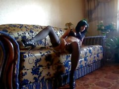 Awesome brunette fingering her pussy