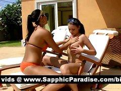 Mignonne Lésbos brune aux gros seins de baiser et dont lesbiennes sexe bord de la piscine