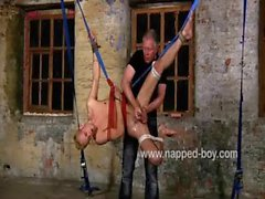 Blond beauty Luke Desmond suspended and jerked off