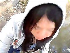 Itämaisia tyttö ottaa hänen cum puiston sisällä ja silitteli tunnin ajan