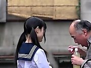 Cute Japanese schoolgirl gives blowjob to a lucky old man