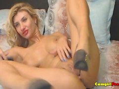 Busty Blonde Babe Inserts Big Dildo in her Pi