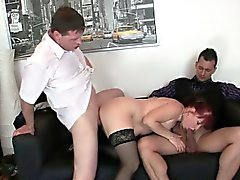 Business woman spreds her old pussy for two cocks