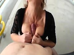 Mature Lady Blows Dick on the Public Porch