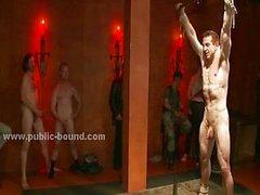 Gay twink with eyes tied in public club