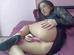 Brunette with a pink dildo