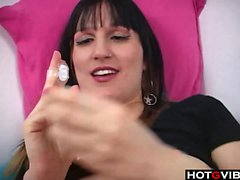 Brunette with sexy nipples rubs her pussy in bed