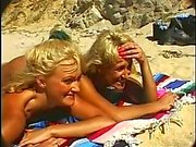 Lucky guy fucks two hot blondes on the beach