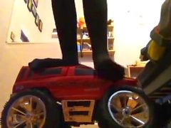 Teen girl crushies big RC truck with nylons