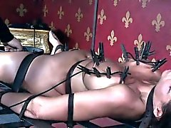 Busty MILF slave gets her tits punished