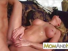 MILF Nicole Sheridan blows younger guy