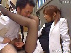 Japanese secretary in pantyhose gives hand and footjob