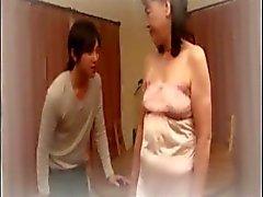 Bir philoshopical Gaper ile coşkulu olgun sıcak şeyler bir genç Jing Jang yapar
