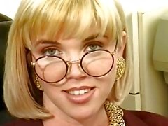 Blonde nerd sticks a dildo up her pussy in the living room