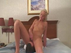Playing with her vibrator while smothering him