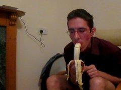 Faggot eating banana