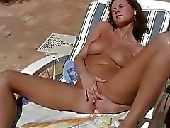 Vibrator caresses pussy