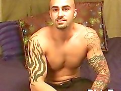 Tattooed and muscular gay hunk shows off his tattooed body