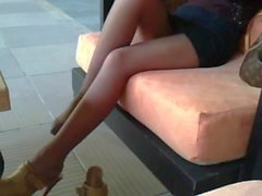 Girl in lobby with panyhose feet