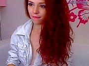 cute redhead strips and masturbates(1).wmv