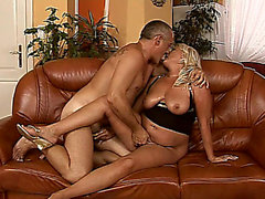 Corpulent blond older with a large gazoo goes wild for a pulsating stick