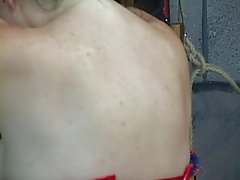 Long haired slave gets her ass spanked till it turns red