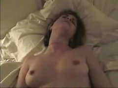 Brunette chick sucks a cock ringed dick