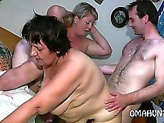 Horny mom loves lesbian fun in bed