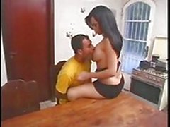 Latina busty shemale banged in the kitchen