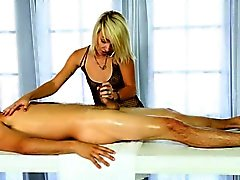 Pretty masseuse sucks off clients cock under the table