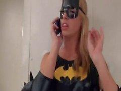 Batgirl masturbates cock with her feet