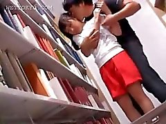 Sweet asian girl getting hot nipples sucked in library