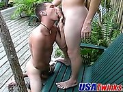 Two cute guys team up to stretch a horny bottoms tight hole