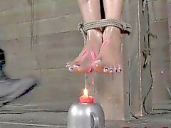 Ebony bdsm sub Nikki Darling candle play