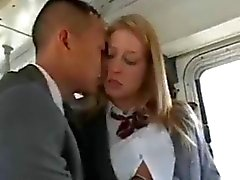 Teen girl fucks an Asian man in a school bus