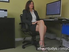 Office worker Alesia Pleasure, screws her shaved mature pussy with a toy.