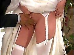 Braut fickt die Hochzeitsphotographie