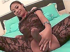Shemale in black rubs her dick