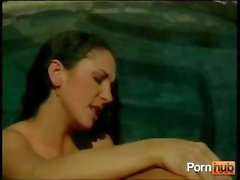 Two hot lesbian babes are in the pool and licking and toying pussy