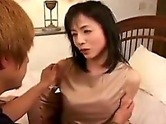 Skinny Asian woman is joined by a younger man and gives him